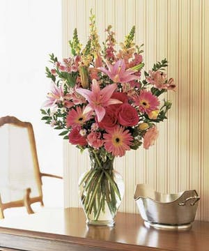 A variety of pink hues in our finest blooms arranged with a wildflower look.